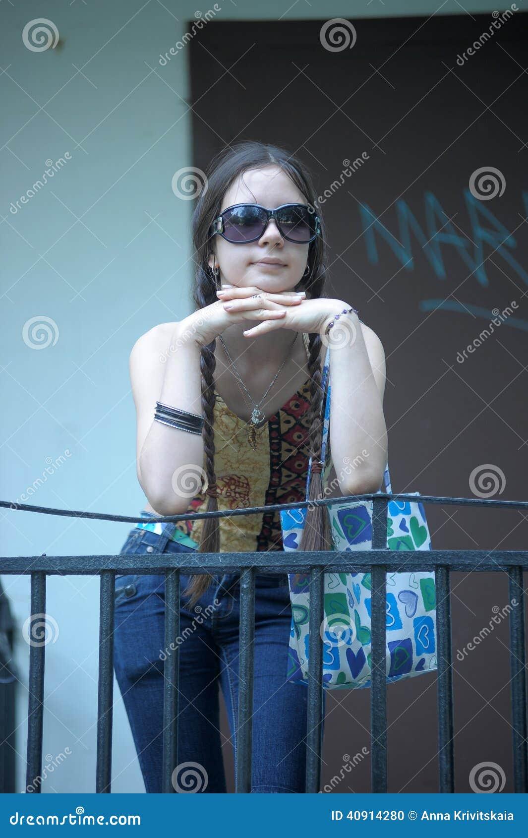 Dark haired teen girl in sunglasses