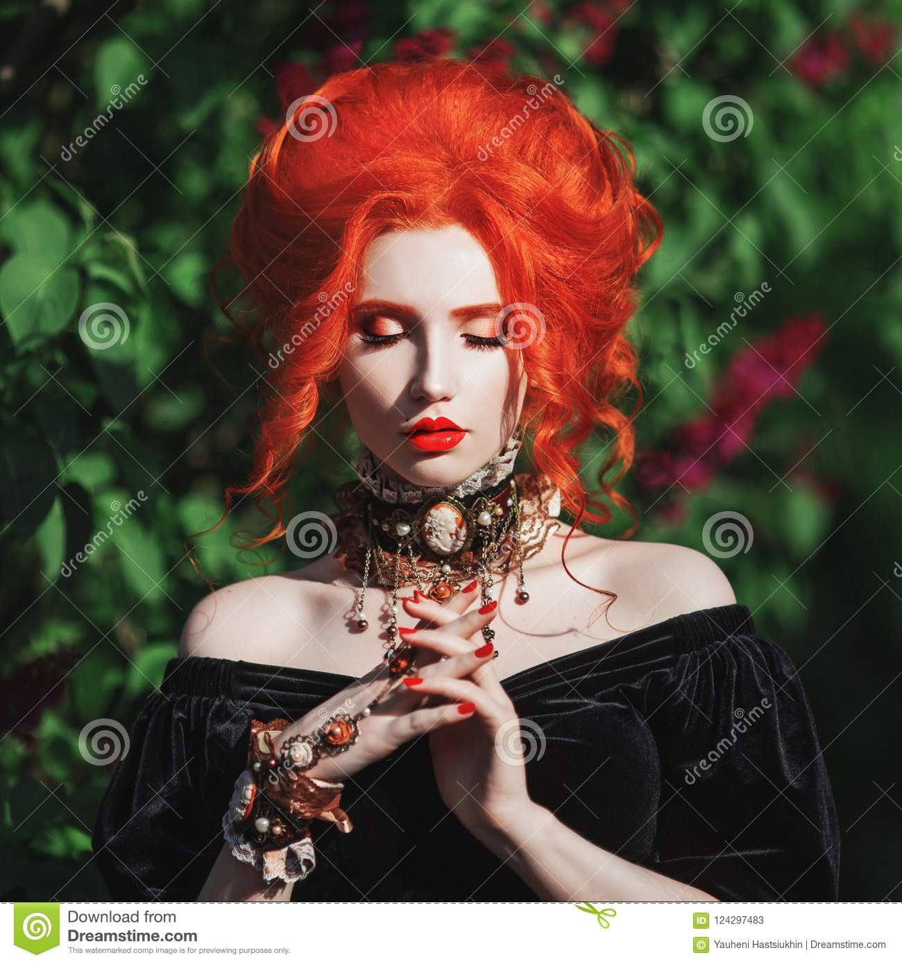 Dark halloween attire. Gothic woman witch with pale skin and red hair in black gown and baroque necklace on neck.