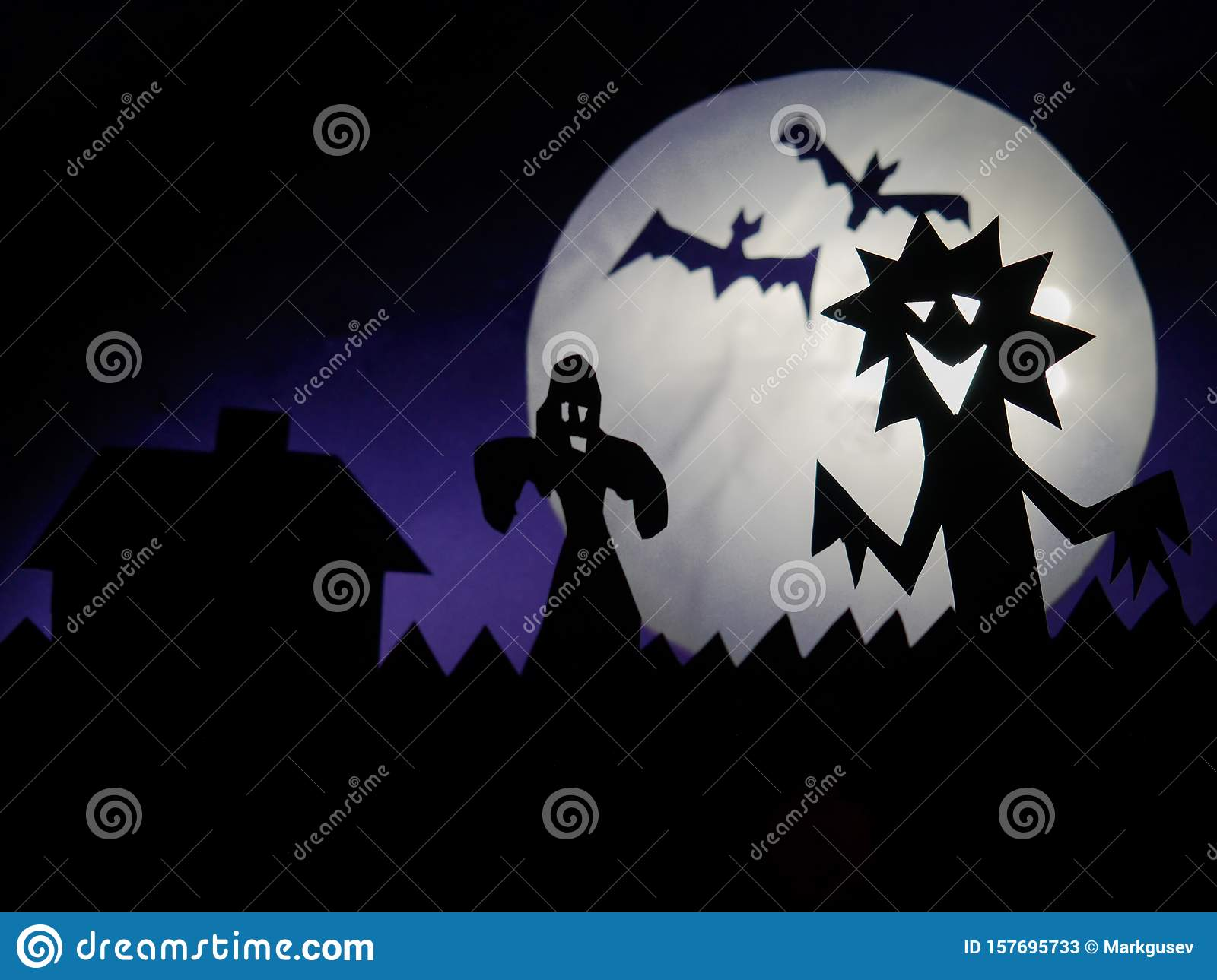 Dark Halloween season background with moon in the background and scary creatures silhouettes. Ghost, bats, and funny monster