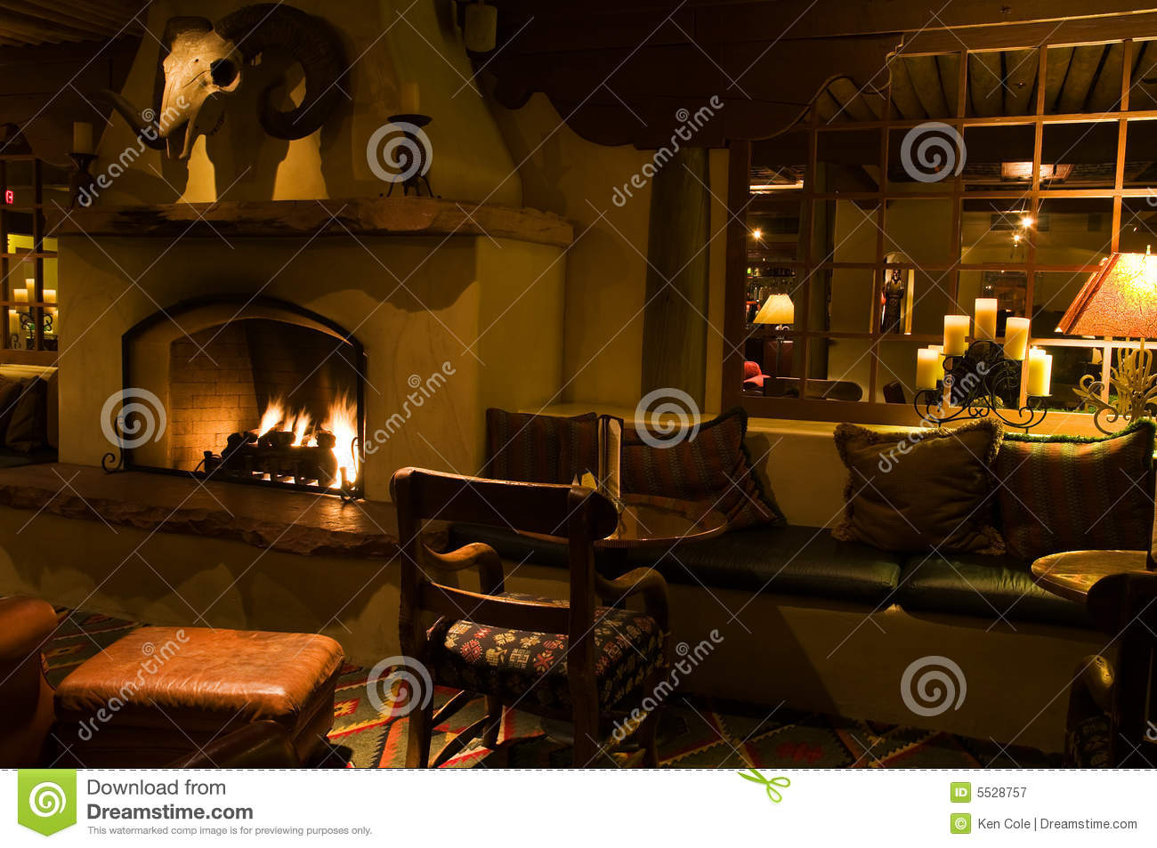 Dark Lounge And Cozy Fireplace Royalty Free Stock