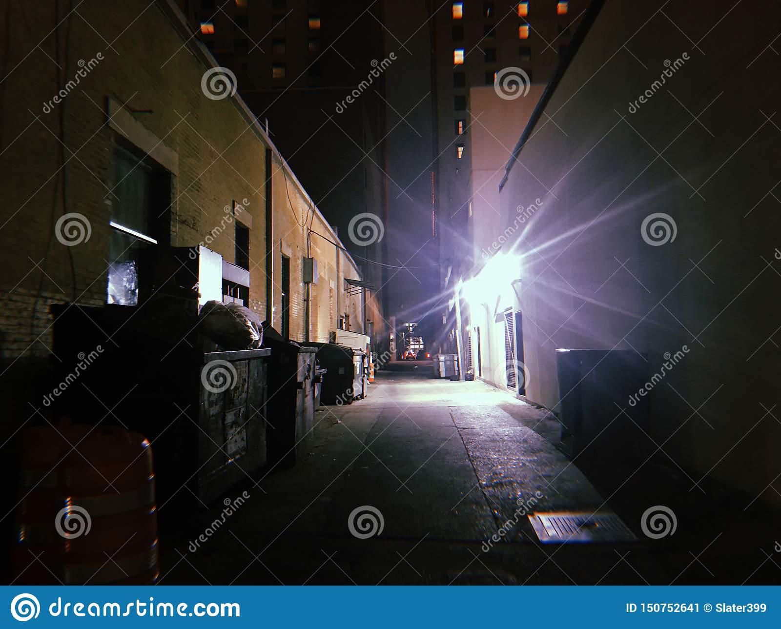 Dark ominous back alley at night