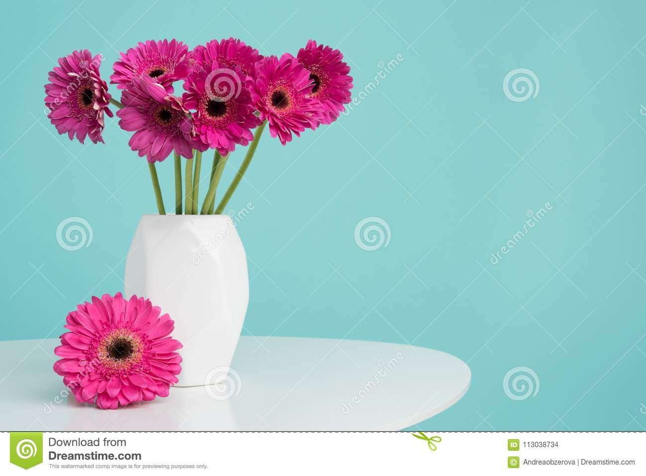 Dark pink gerberas in a vase on a retro table. Happy Mother`s Day, Women`s Day, Valentine`s Day or Birthday background.