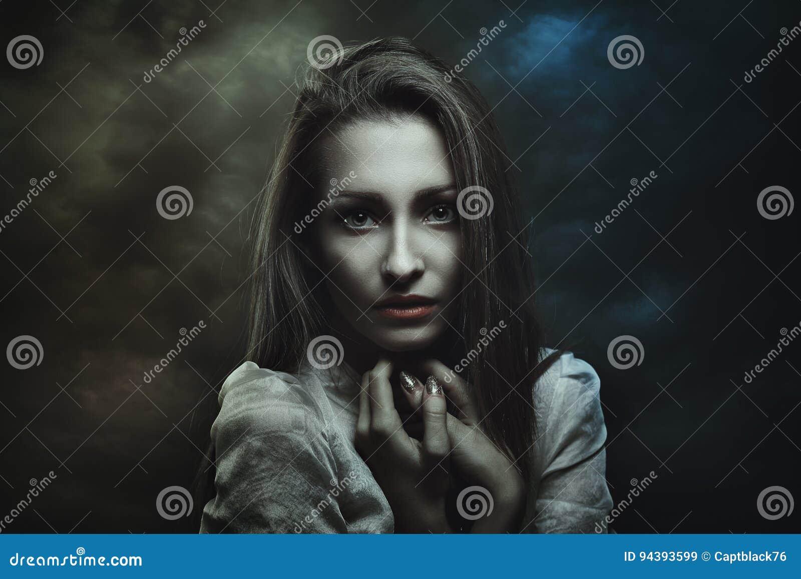 Dark portrait of mysterious woman