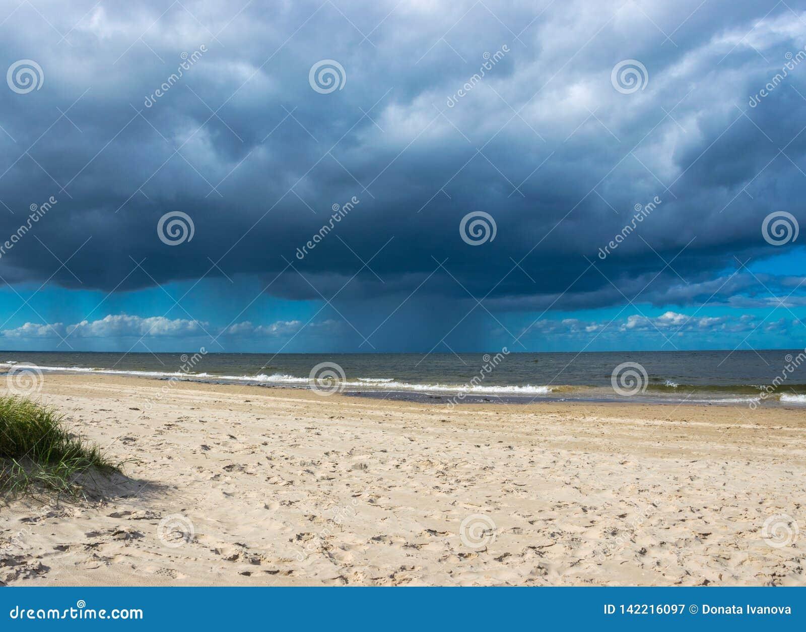 Dark rain clouds above the Baltic sea. Raining