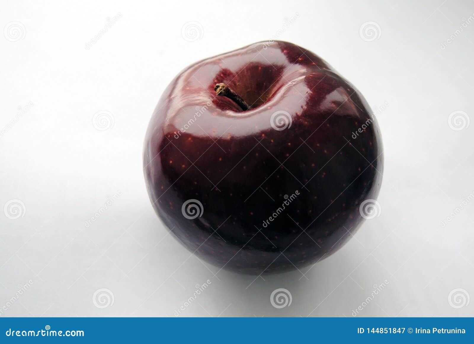 Dark red apple on a white background