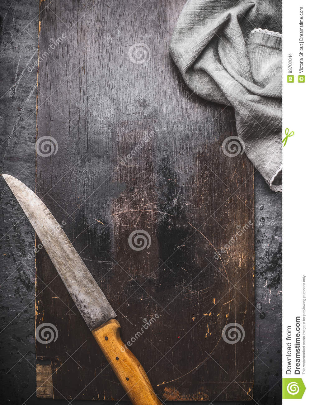 Dark Rustic Food Background With Kitchen Knife And Napkin Stock Photo