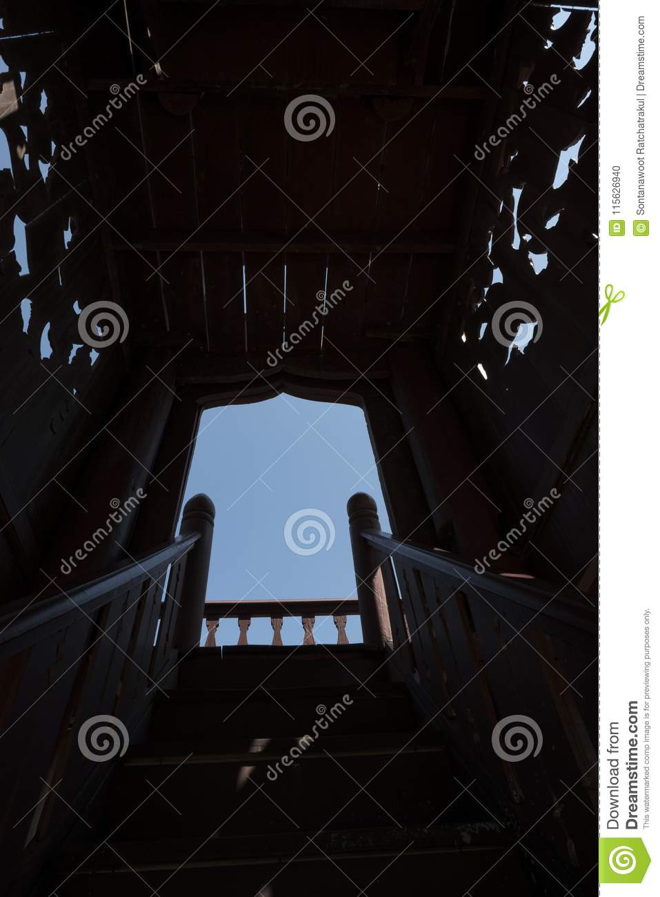 Dark stairs and walkway up to the sky. Wooden stair to step up to opening sky.