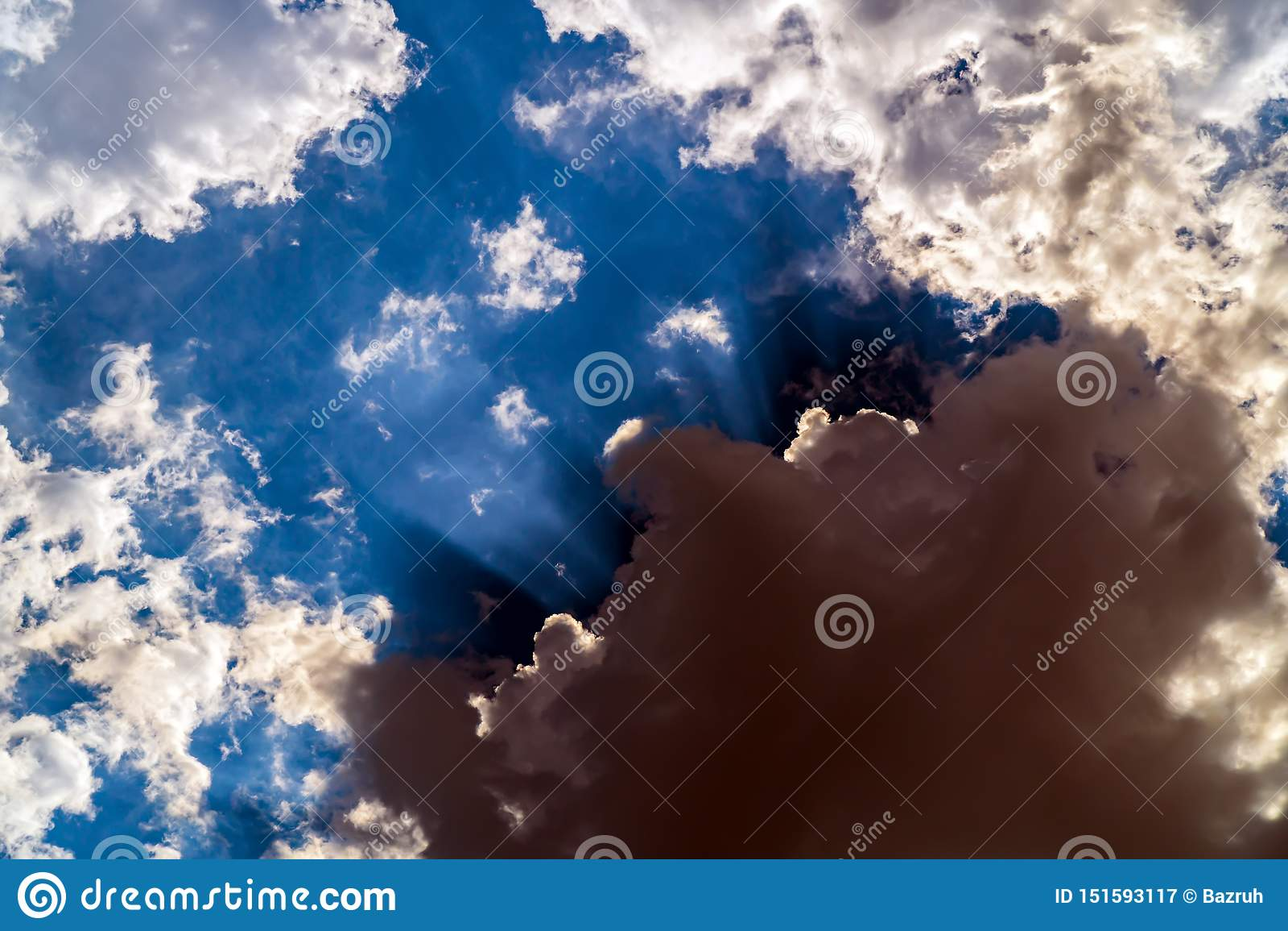 Dark storm clouds on a bright blue sky