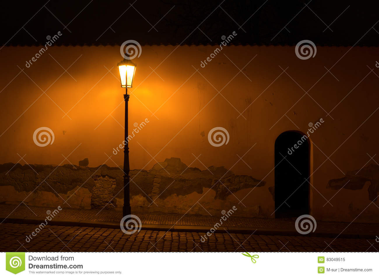 Street With Old Retro Lamp Post In Front Of The Wall Cracked Plaster Dark Scenery During Night Scene Is Lit By Poor Yellow Light Lantern