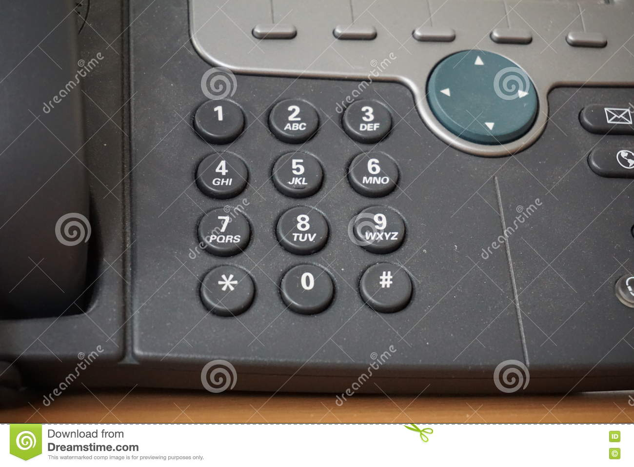 dark telephone dial buttons of the land line phone with numbers together with a speed