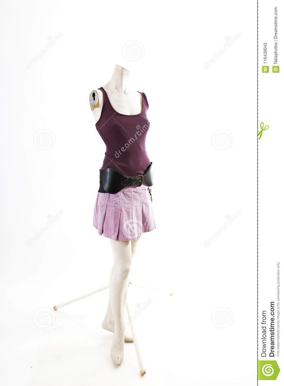 Dark top and purple mini skirt summer spring wear on mannequin full body shop display. Woman fashion styles, clothes on white stud