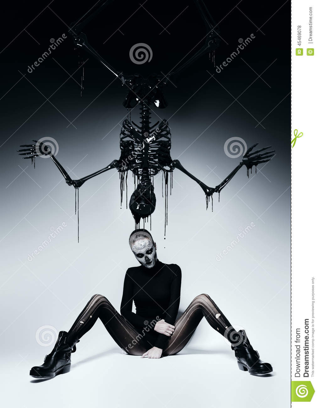 Dark Woman With Skull Face And Black Skeleton Stock Photo