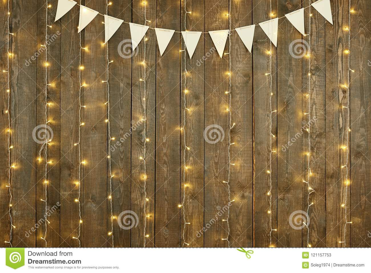 Dark wood background with lights and flags, abstract holiday backdrop, copy space for text