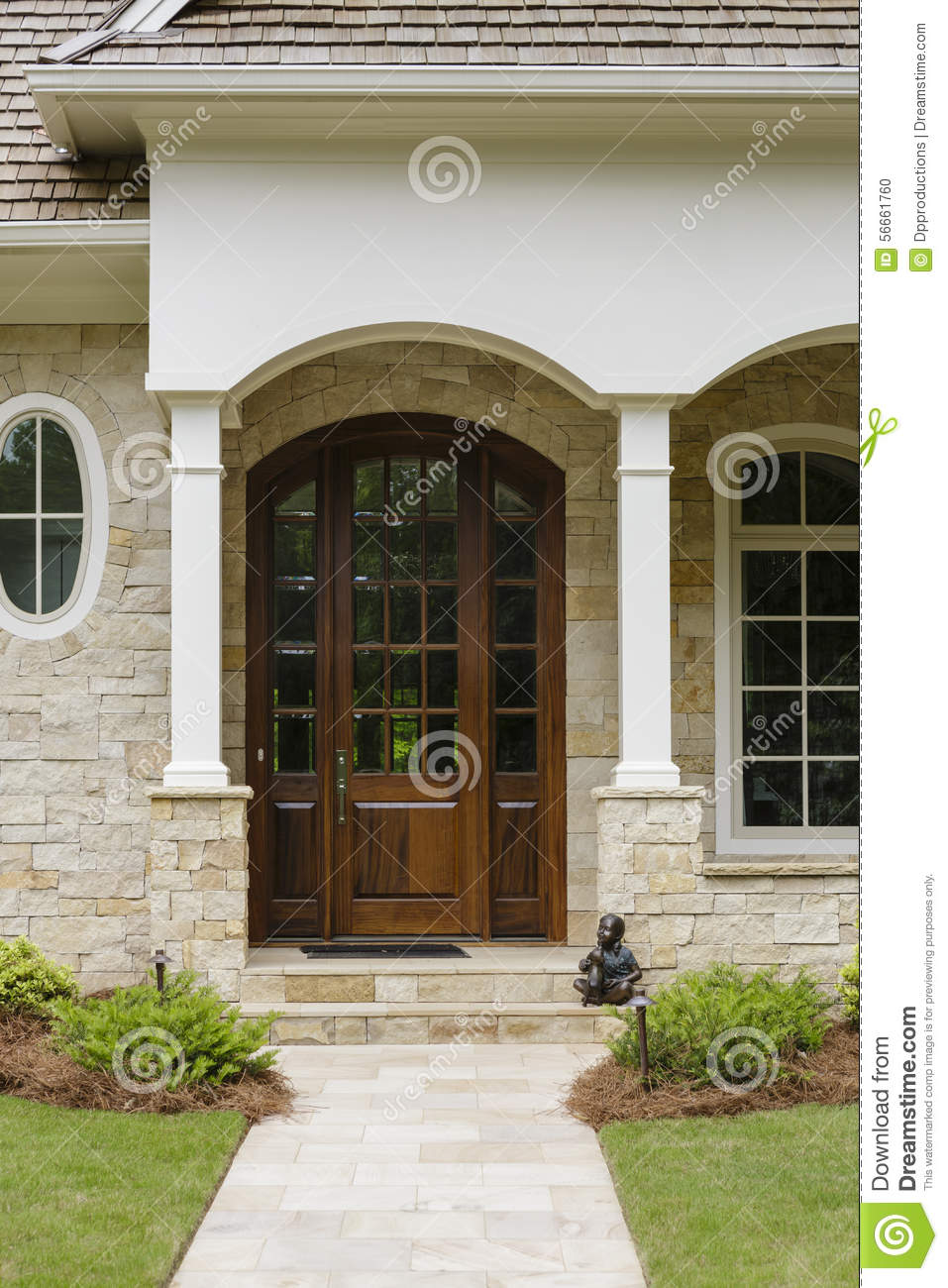 Dark wood door with arches and a brick facade stock photo - Casas rusticas con jardin ...