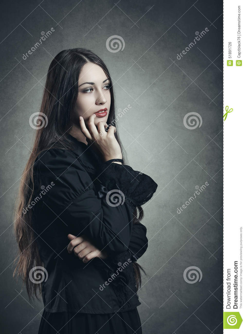 Dark young woman in thinking position