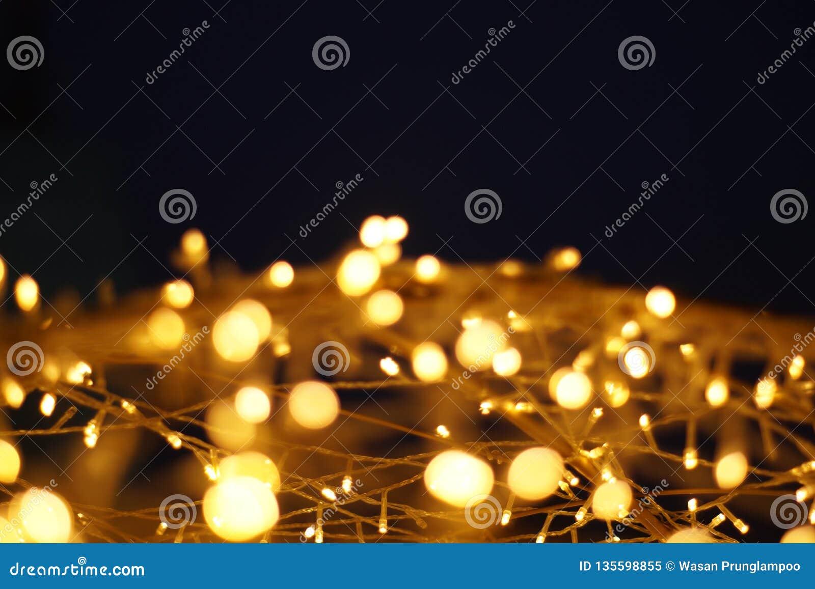 Das goldene LED-Licht bokeh verwischte abstrakten Musterhintergrund