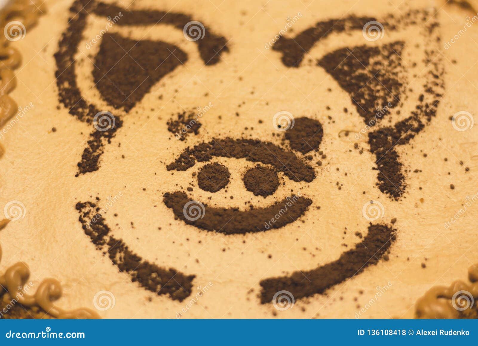 Das Muster auf dem Kuchen in Form einer Schweinmündung