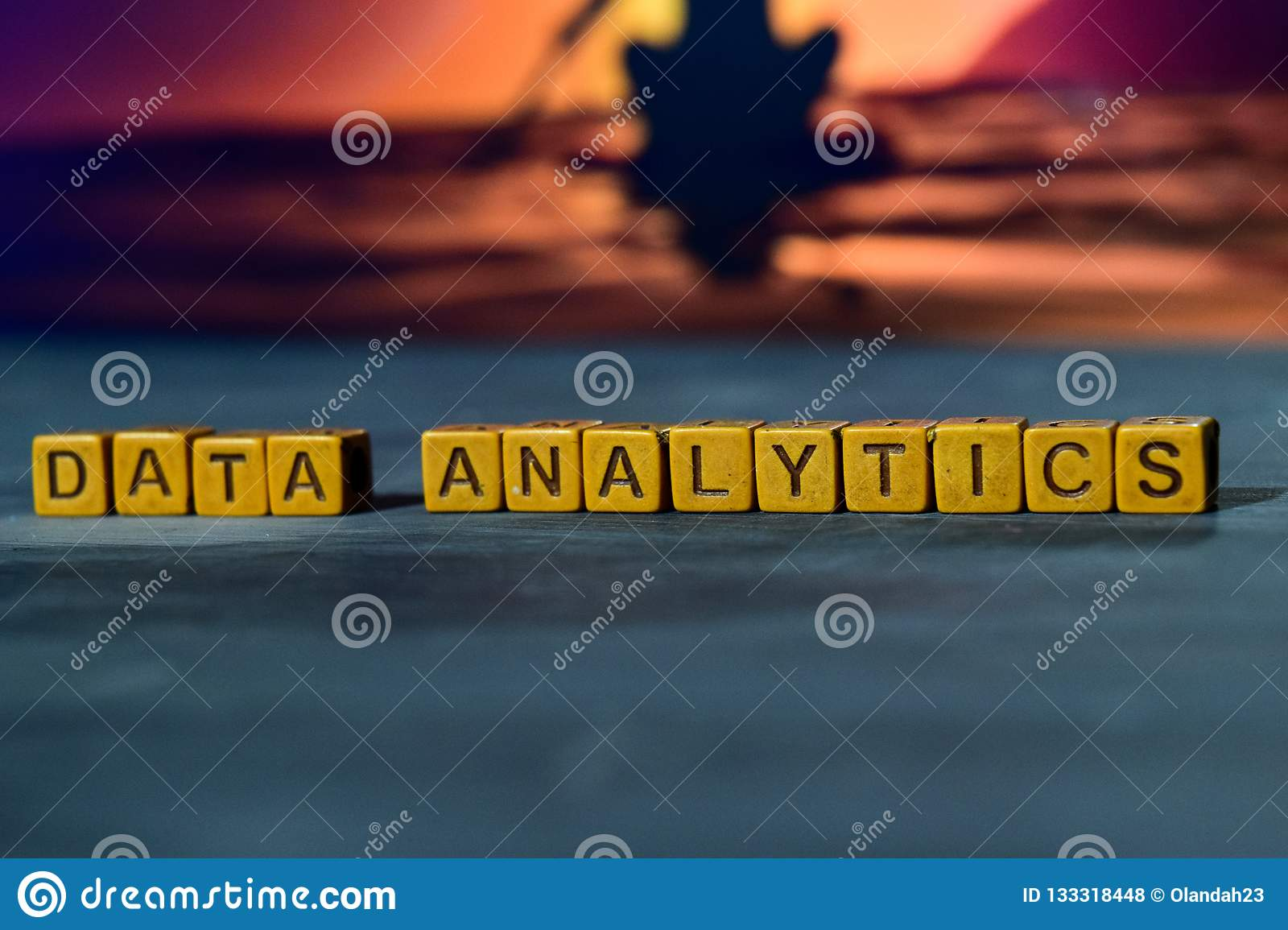 Data analytics on wooden blocks. Cross processed image with bokeh background