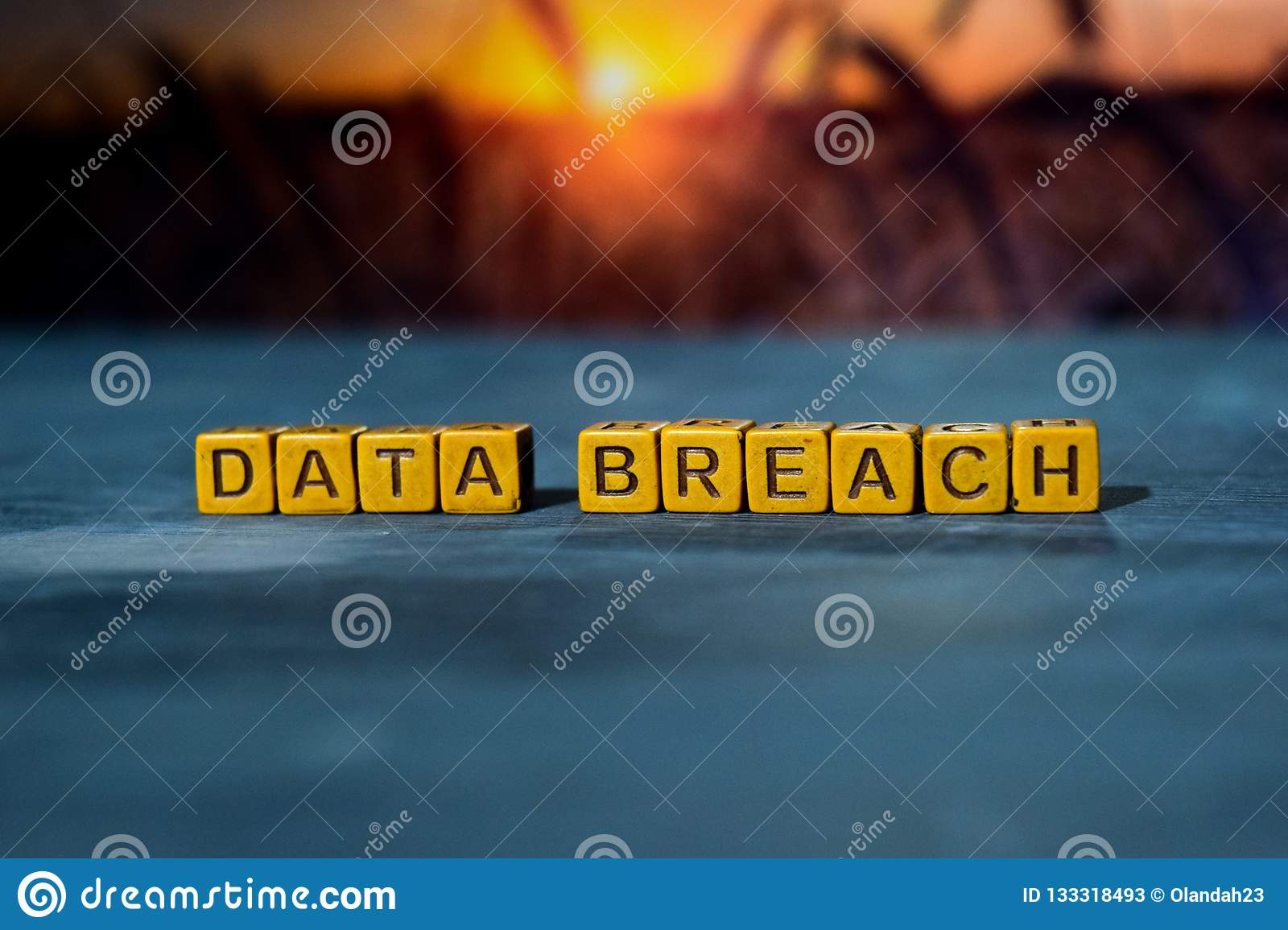 Data breach on wooden blocks. Cross processed image with bokeh background