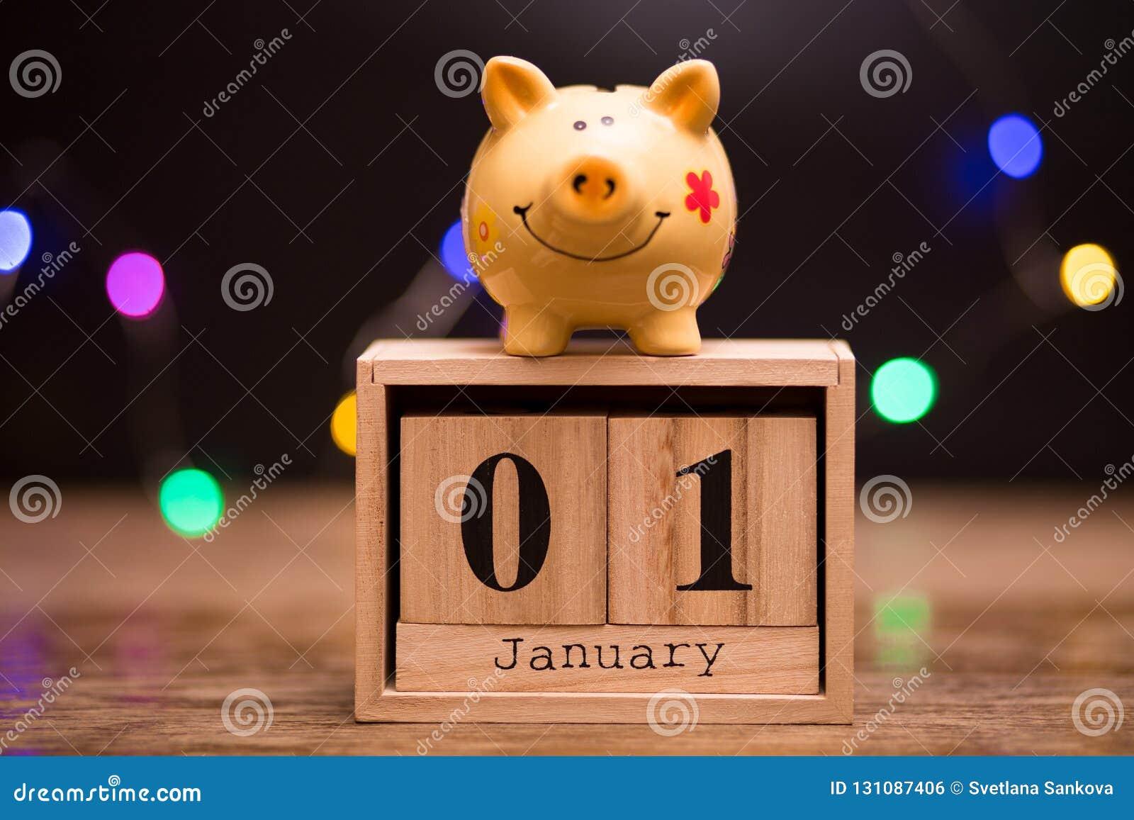 Data de calendário do começo do exercício orçamental, o 1º de janeiro com o mealheiro no fundo escuro