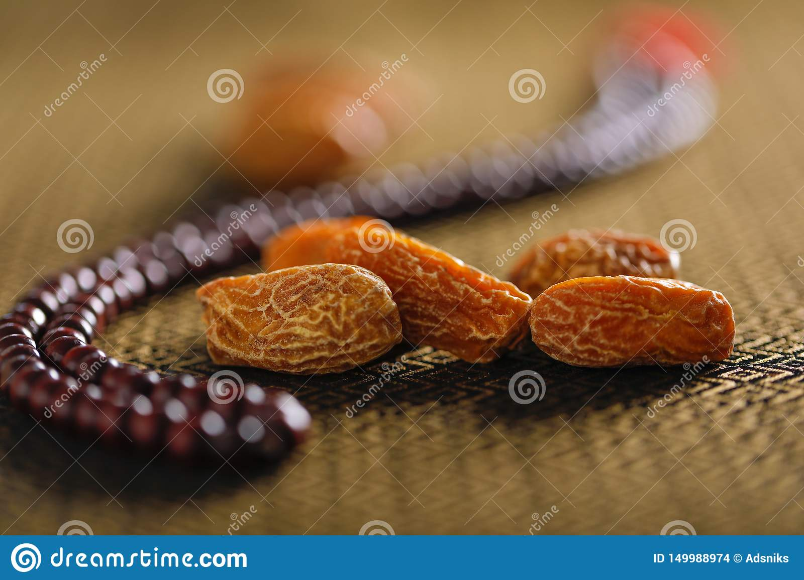 Date Fruits With An Islamic Prayer Beads On An Artistic