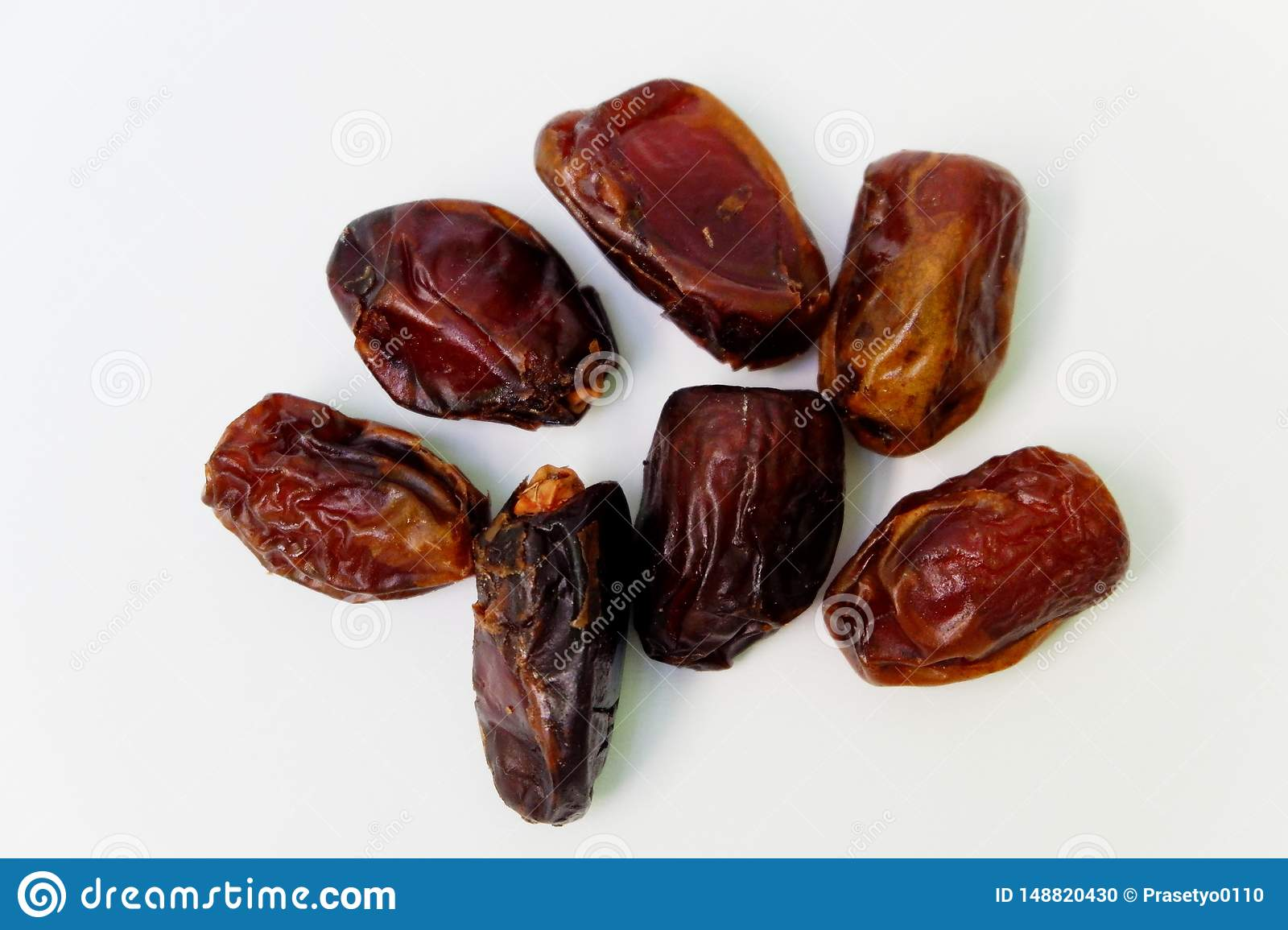 Dates fruits  on white background. Top view close up details.