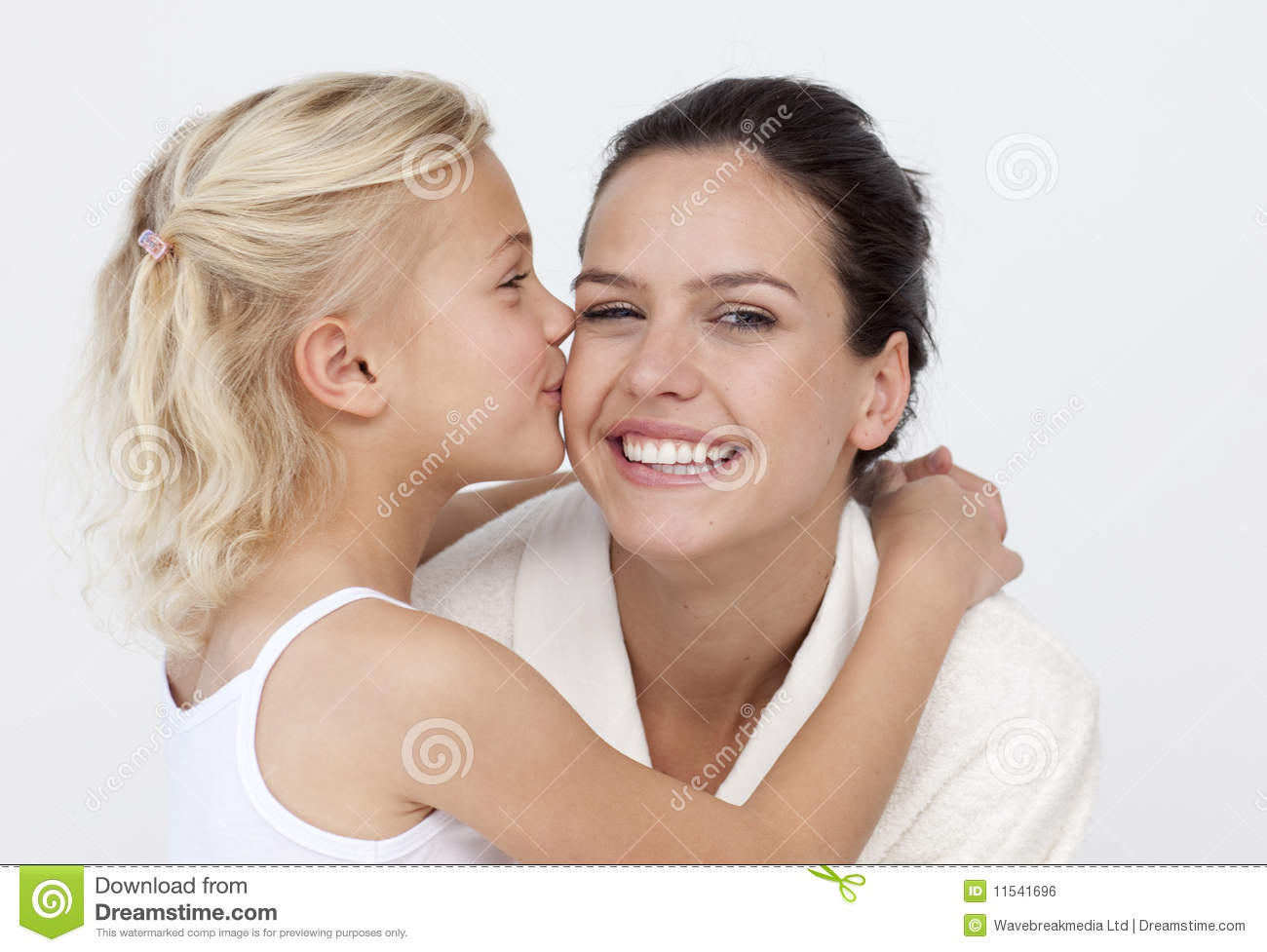 Daughter Kissing Her Mother In Bathroom Royalty Free Stock