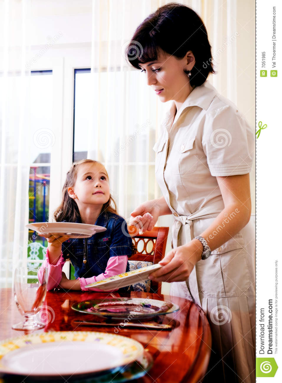 Daughter And Mom Setting The Table Royalty Free Stock ...