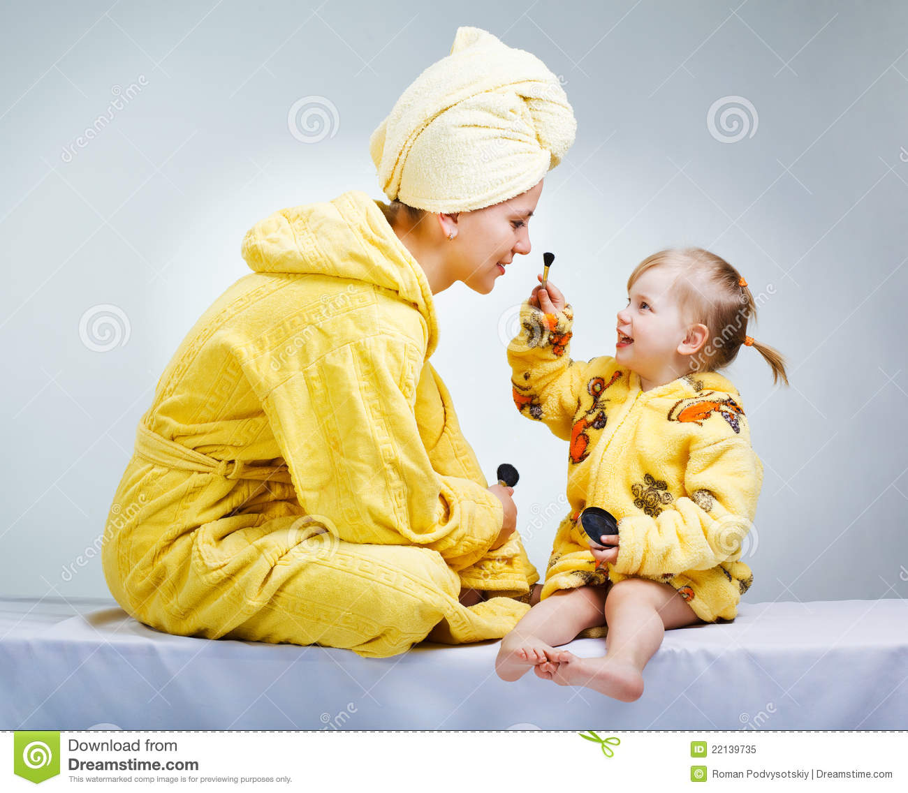 Daughter And Mother Putting Makeup Royalty Free Stock