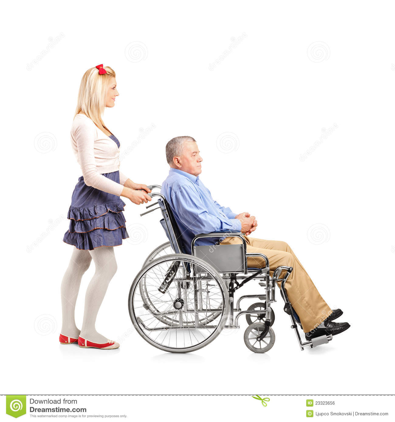 Daughter Pushing Her Dad In A Wheelchair Stock Photo