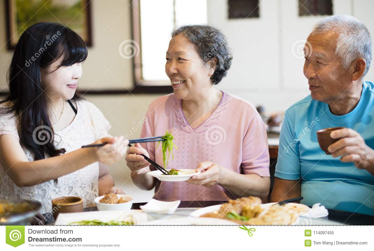 Daughter And Senior Parent Enjoy Dinner Stock Image - Image