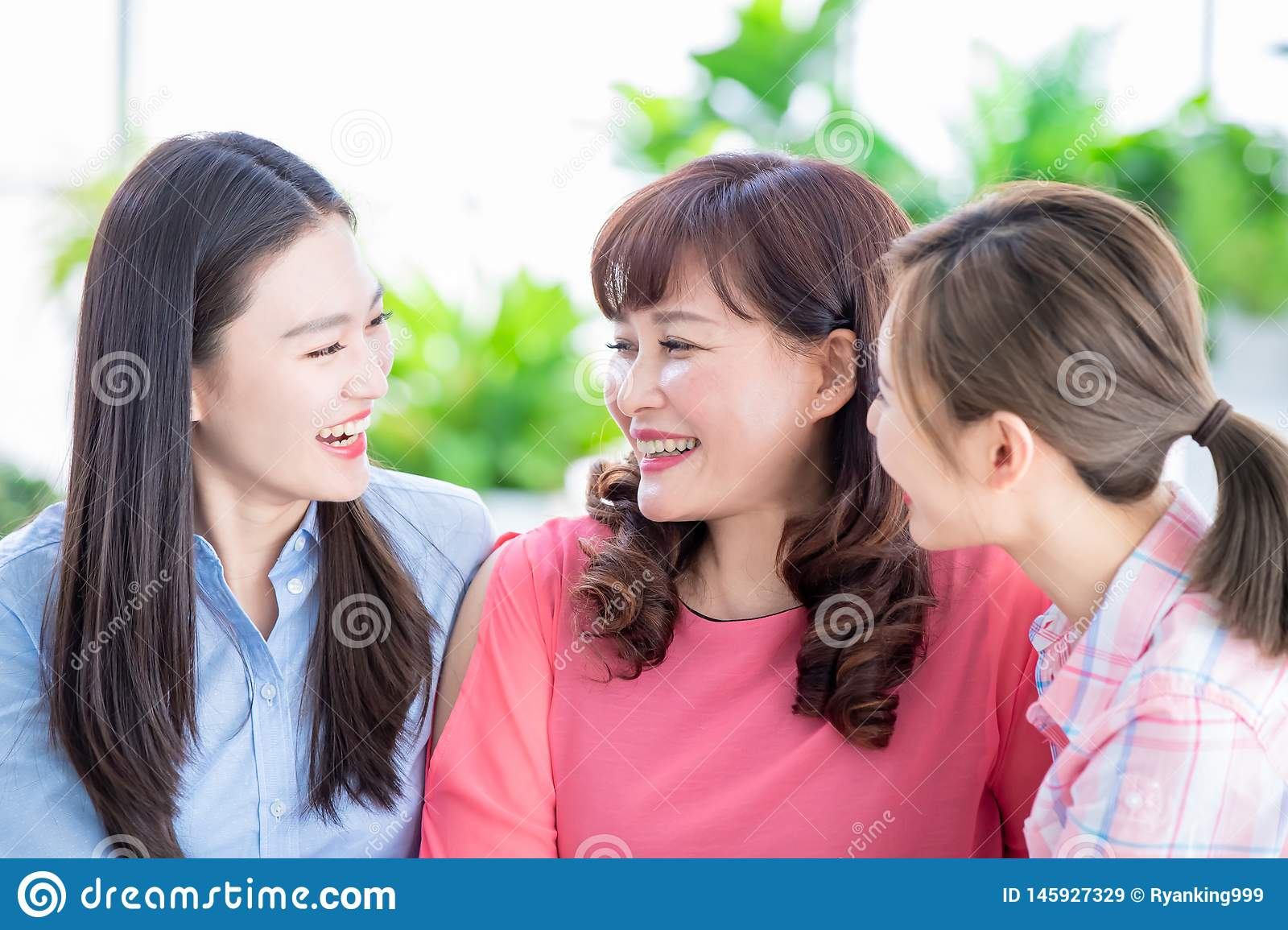 Daughters talk to mother happily