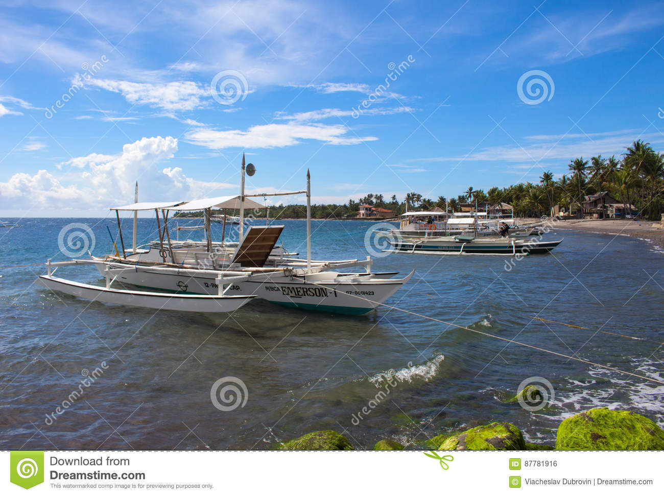 Dauin, Philippines - 26 June, 2016: Sea and the boats moored near the shore