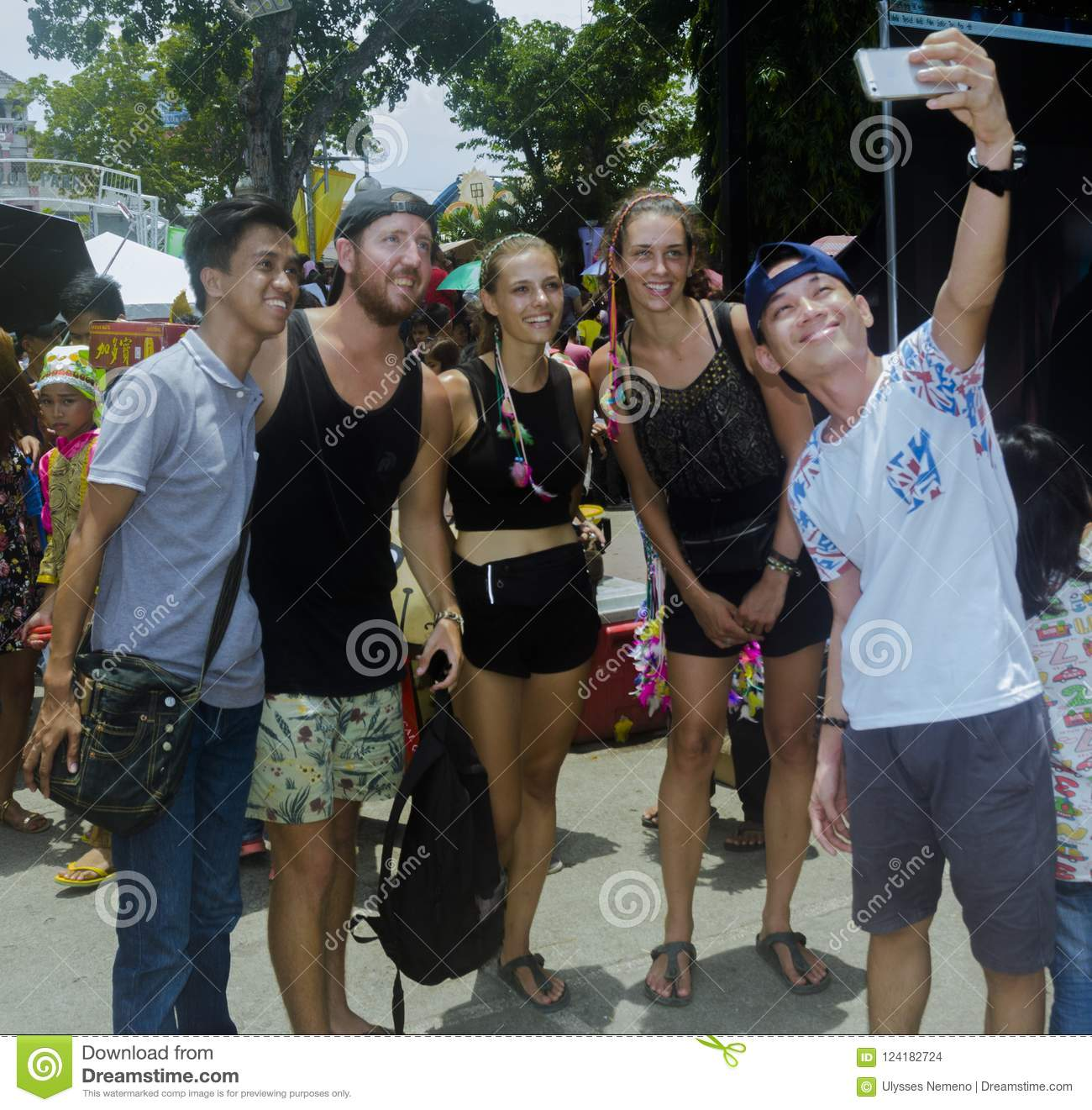 Locals selfie with tourists during 2018 Kadayawan Festival in Davao