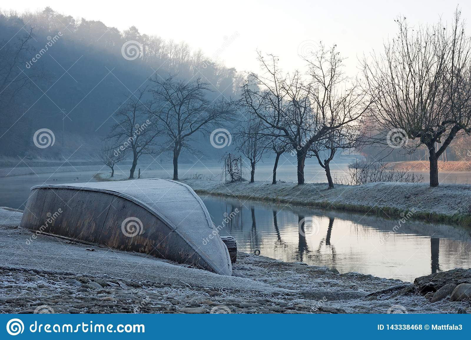 Dawn on Ticino river in a frozen morning