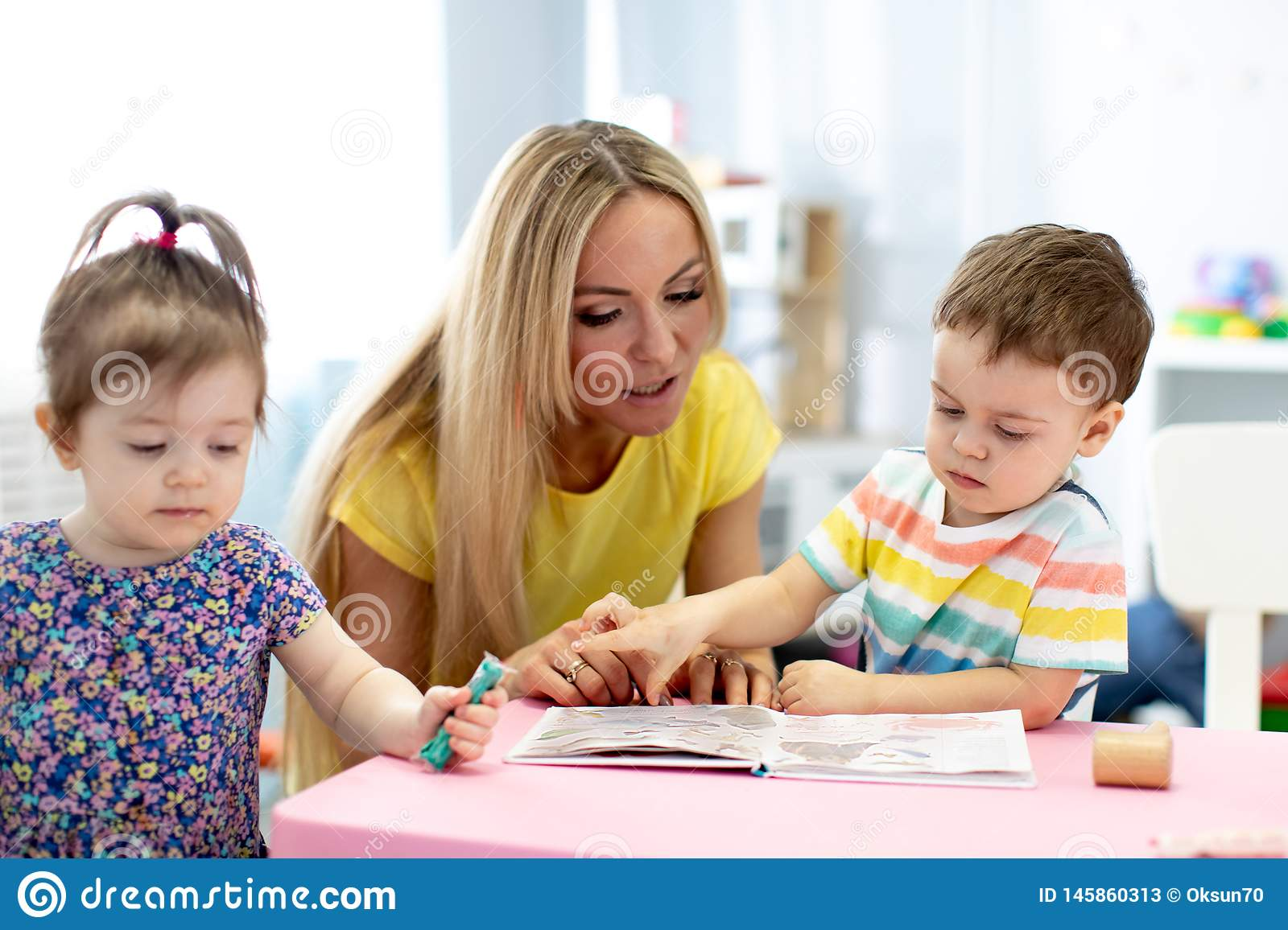 day-care-worker-children-kids-reading-book-kindergarten-day-care-worker-children-reading-book-kindergarten-145860313.jpg?profile=RESIZE_400x