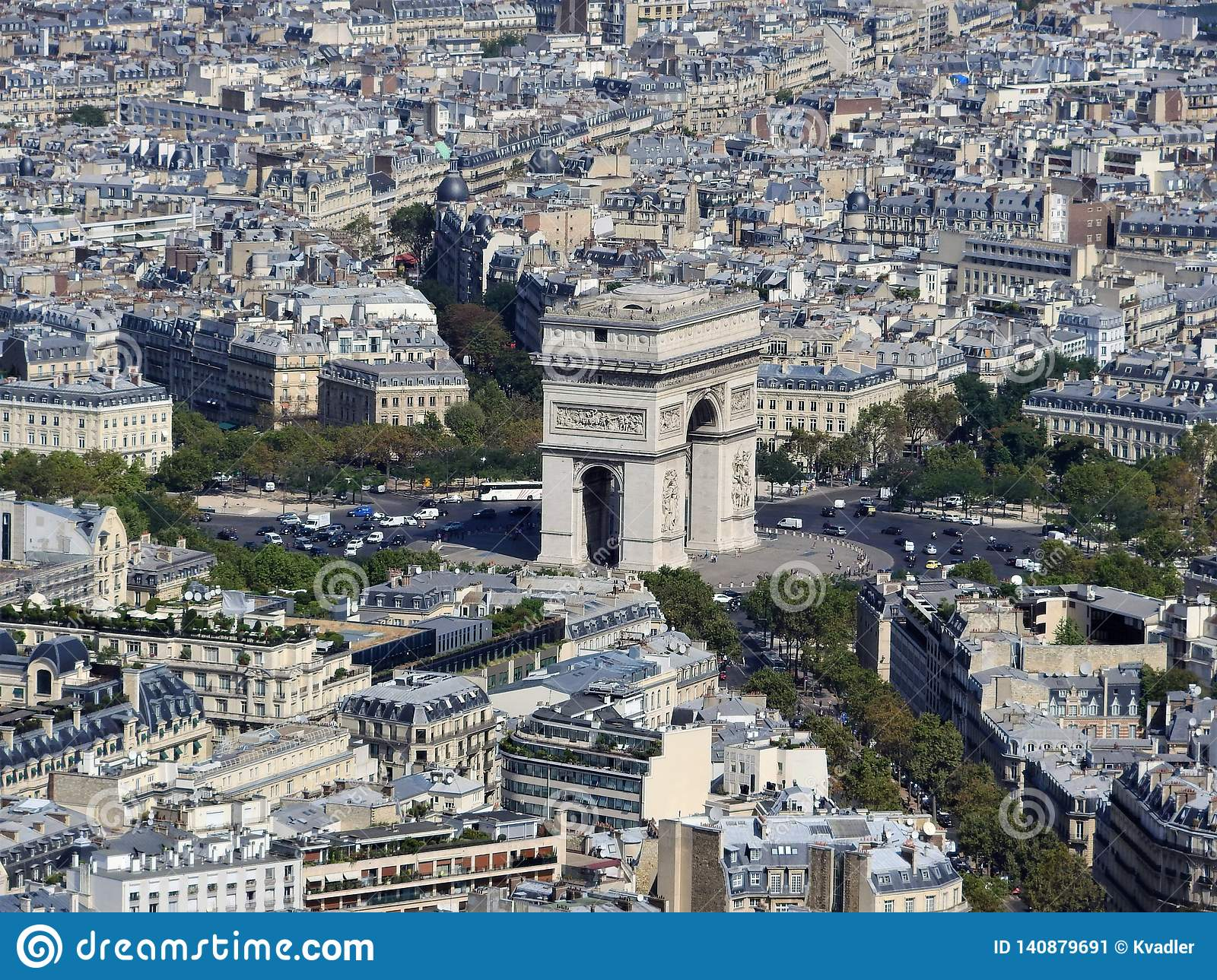 Day view of the arc de Triomphe and Paris from the height of the Eiffel tower