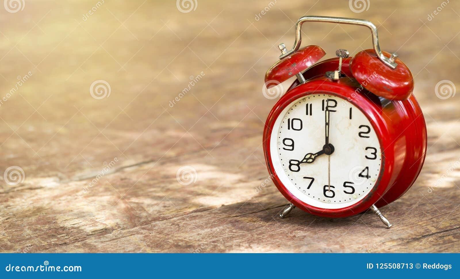 Daylight savings time - vintage red alarm clock banner