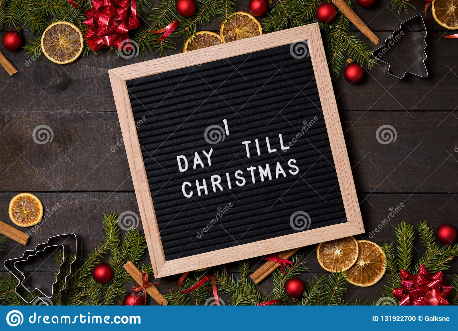 One Day till Christmas countdown letter board on dark rustic wood
