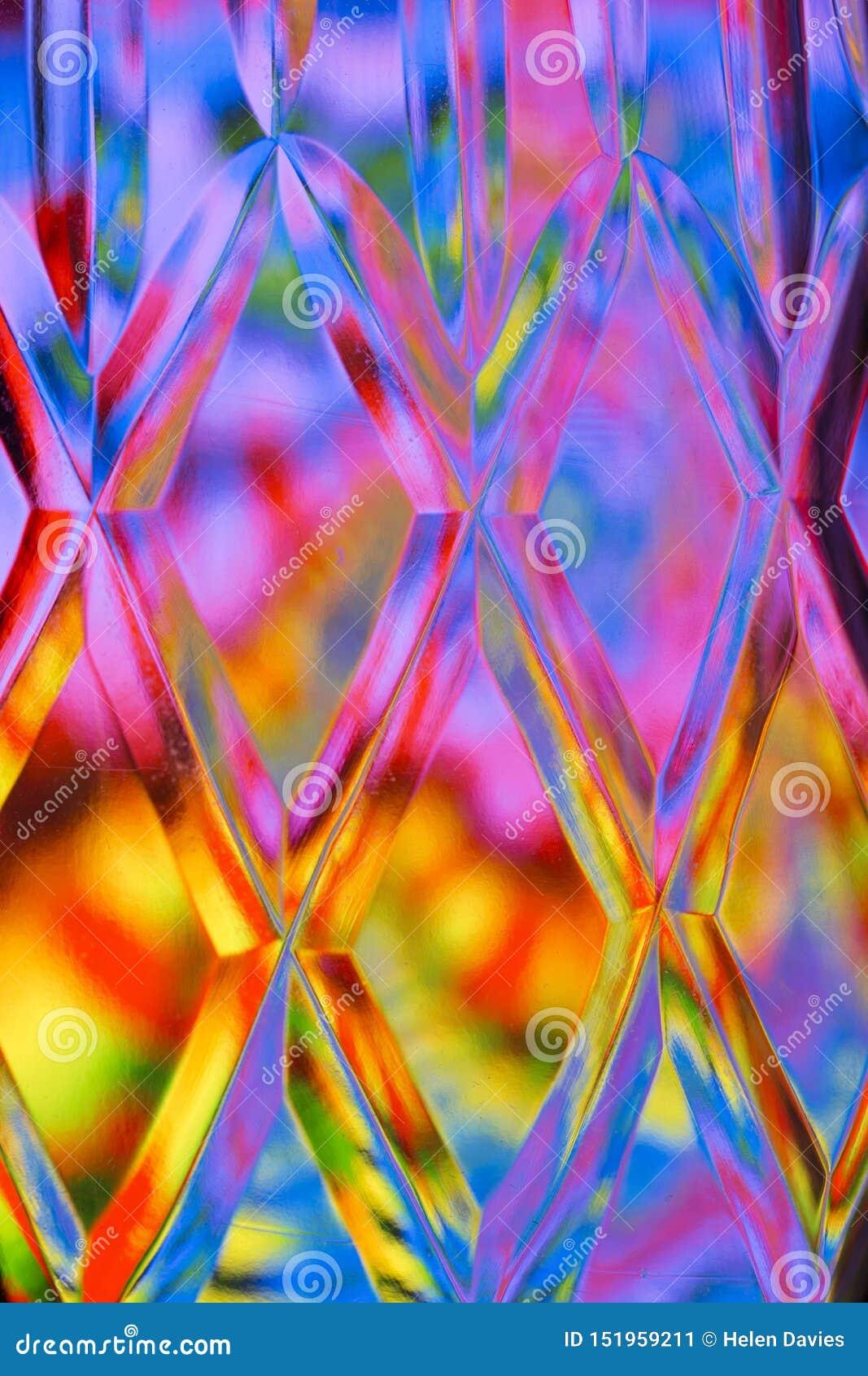 De abstracte kleurrijke achtergrond van het besnoeiingsglas