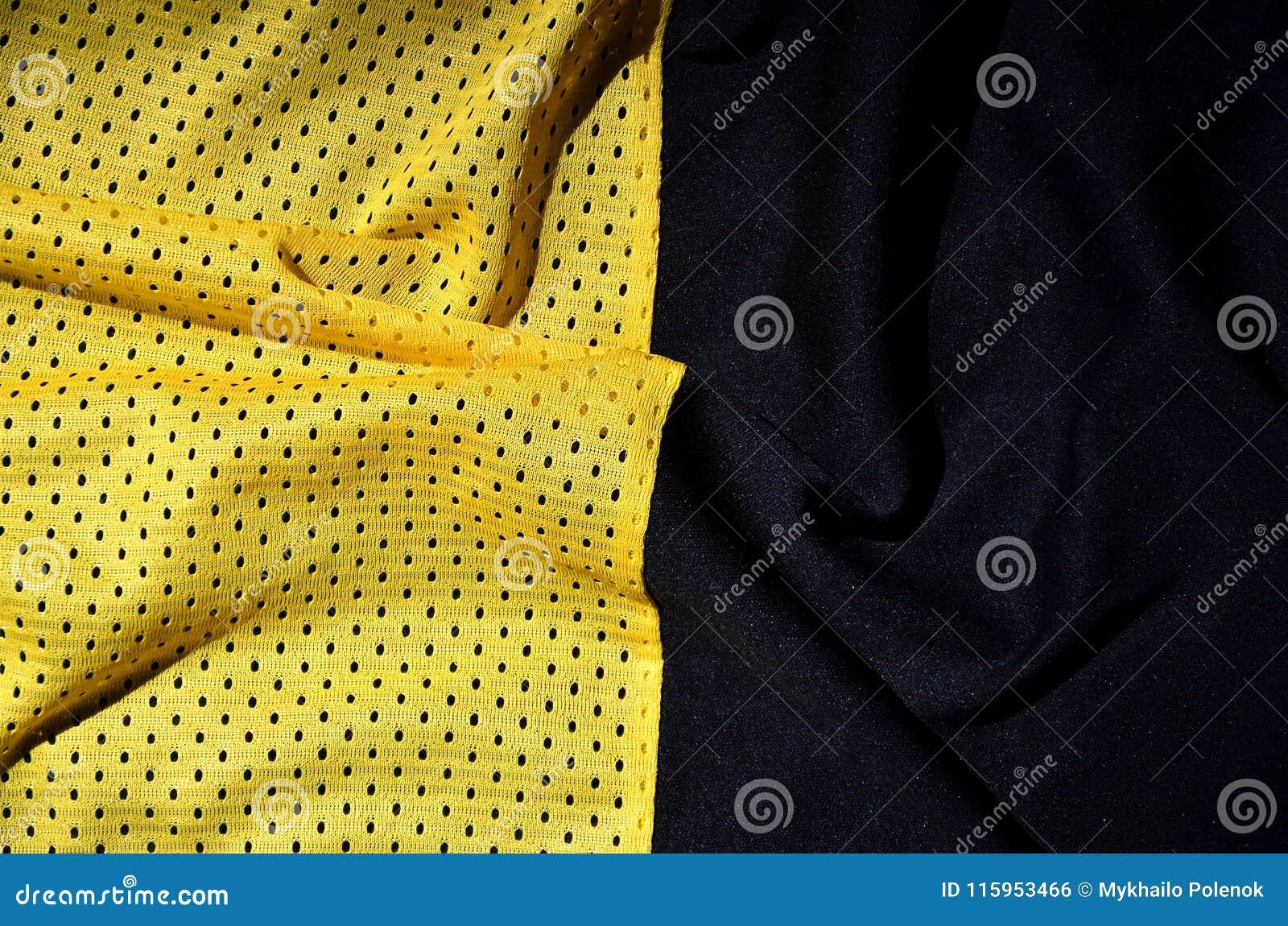 De achtergrond van de de stoffentextuur van de sportkleding Hoogste mening van de gele textieloppervlakte van de polyester nylon
