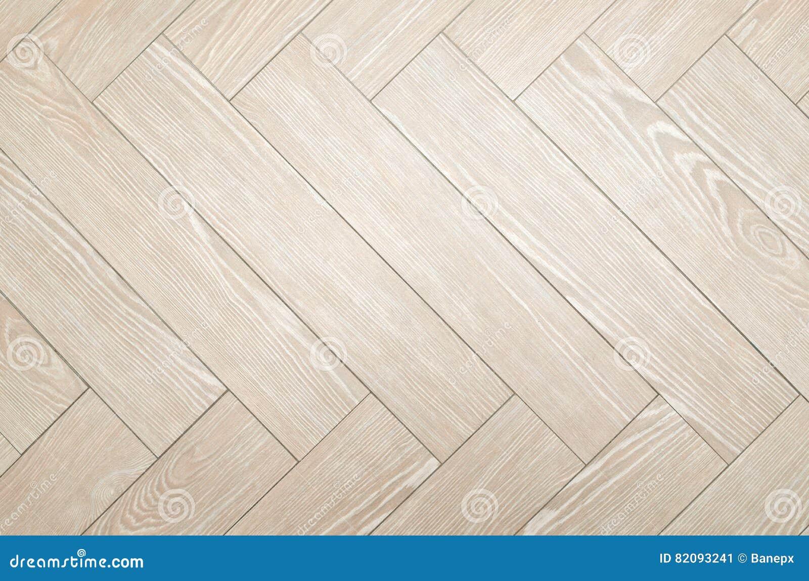 De beige tegels van de visgraatvloer stock afbeelding afbeelding