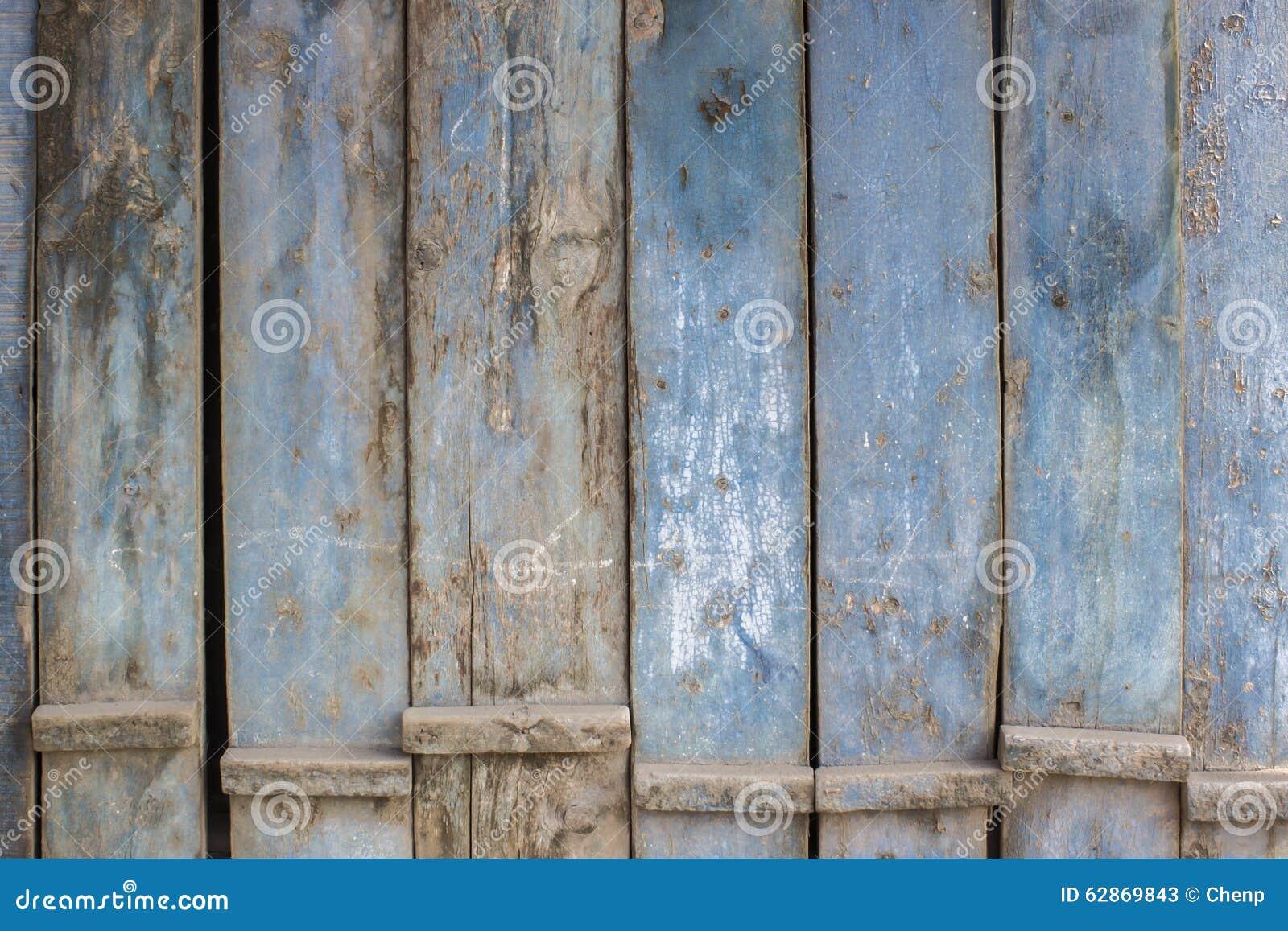 De blauwe grijze verf vlekte houten deuren stock afbeelding