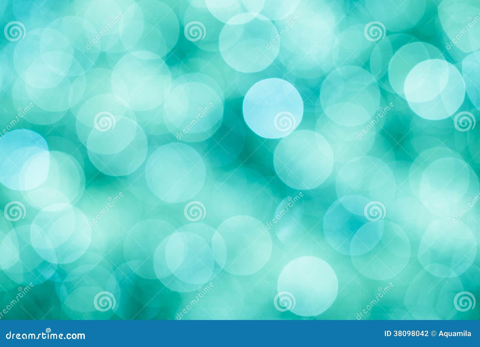 De blauwe, groene en turkooise achtergrond met bokeh defocused lichten
