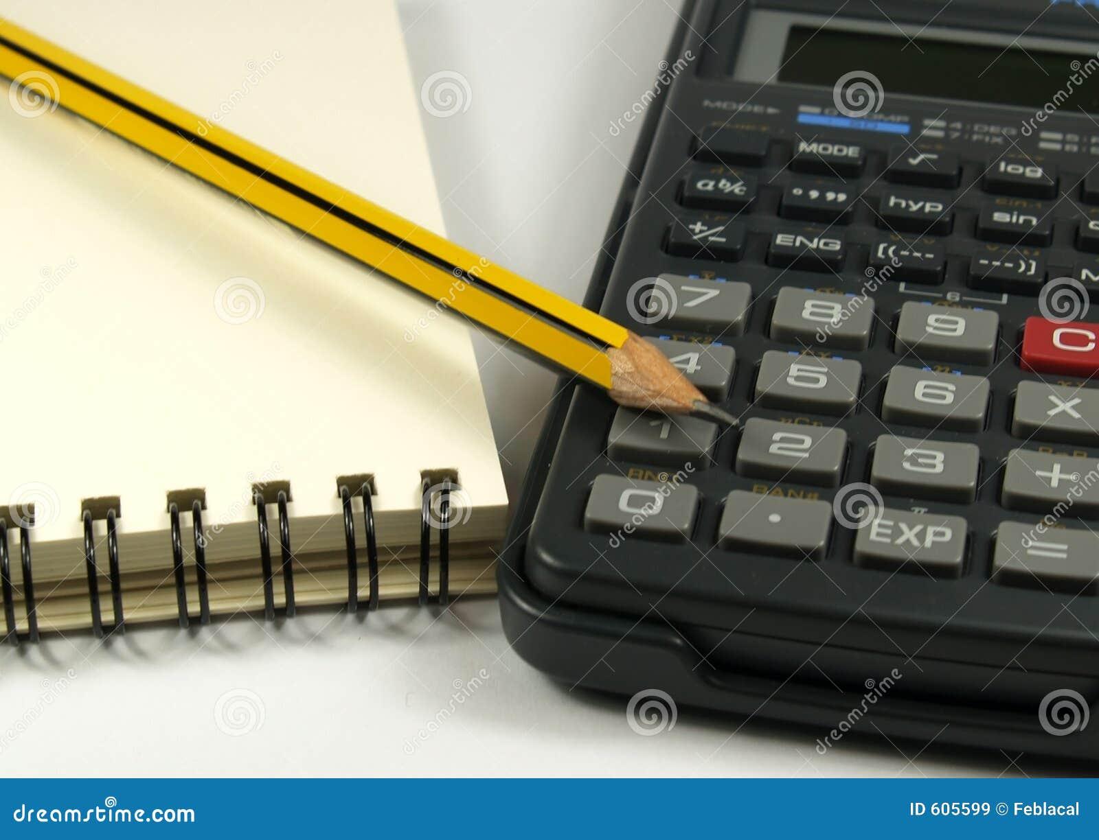 De blocnote en de calculator van het potlood