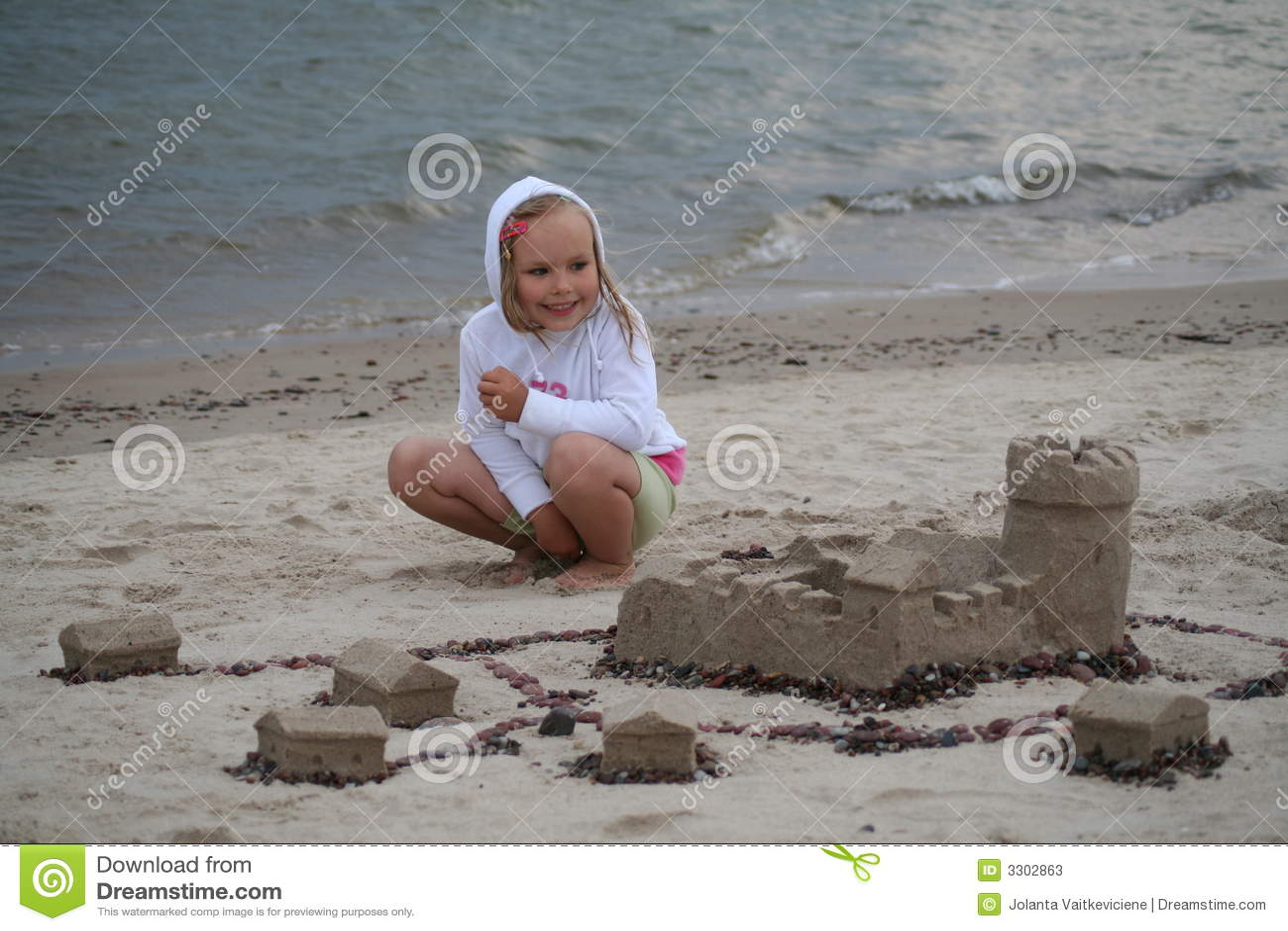 De bouwer van het zandkasteel