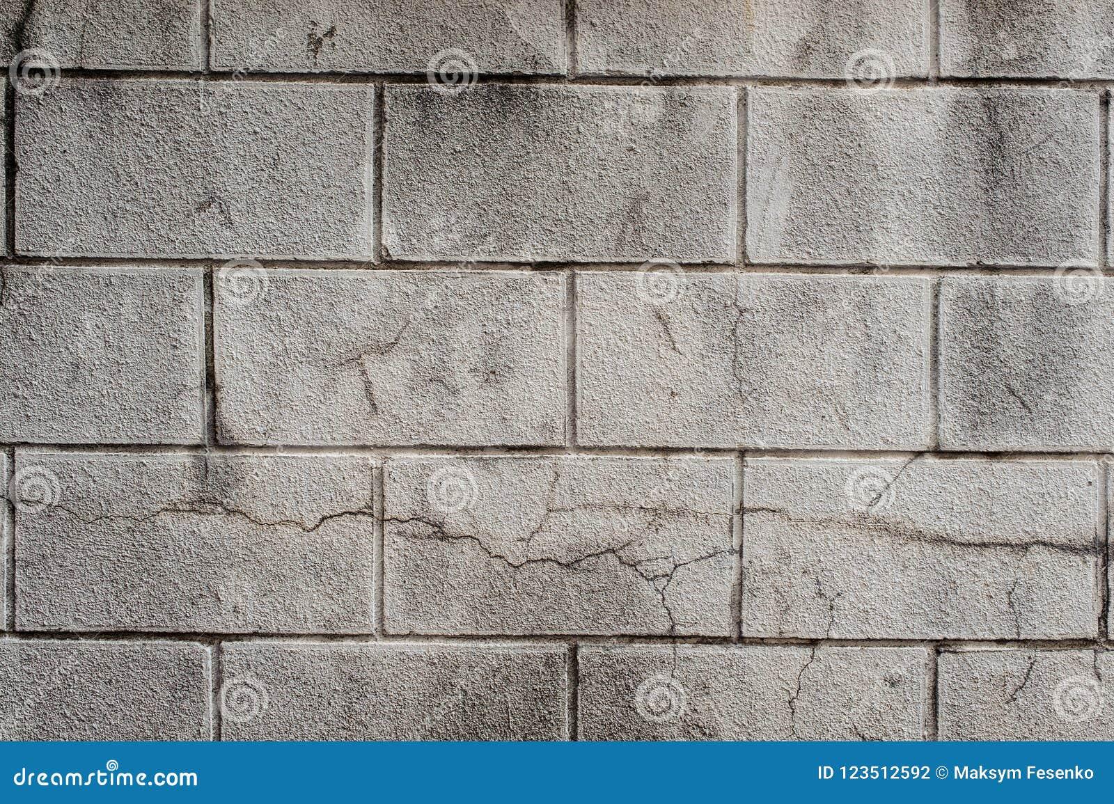 Decoratie Aan De Muur Buiten.De Buiten Grijze Muur Van Het Sintelblok Met Lijnen Van