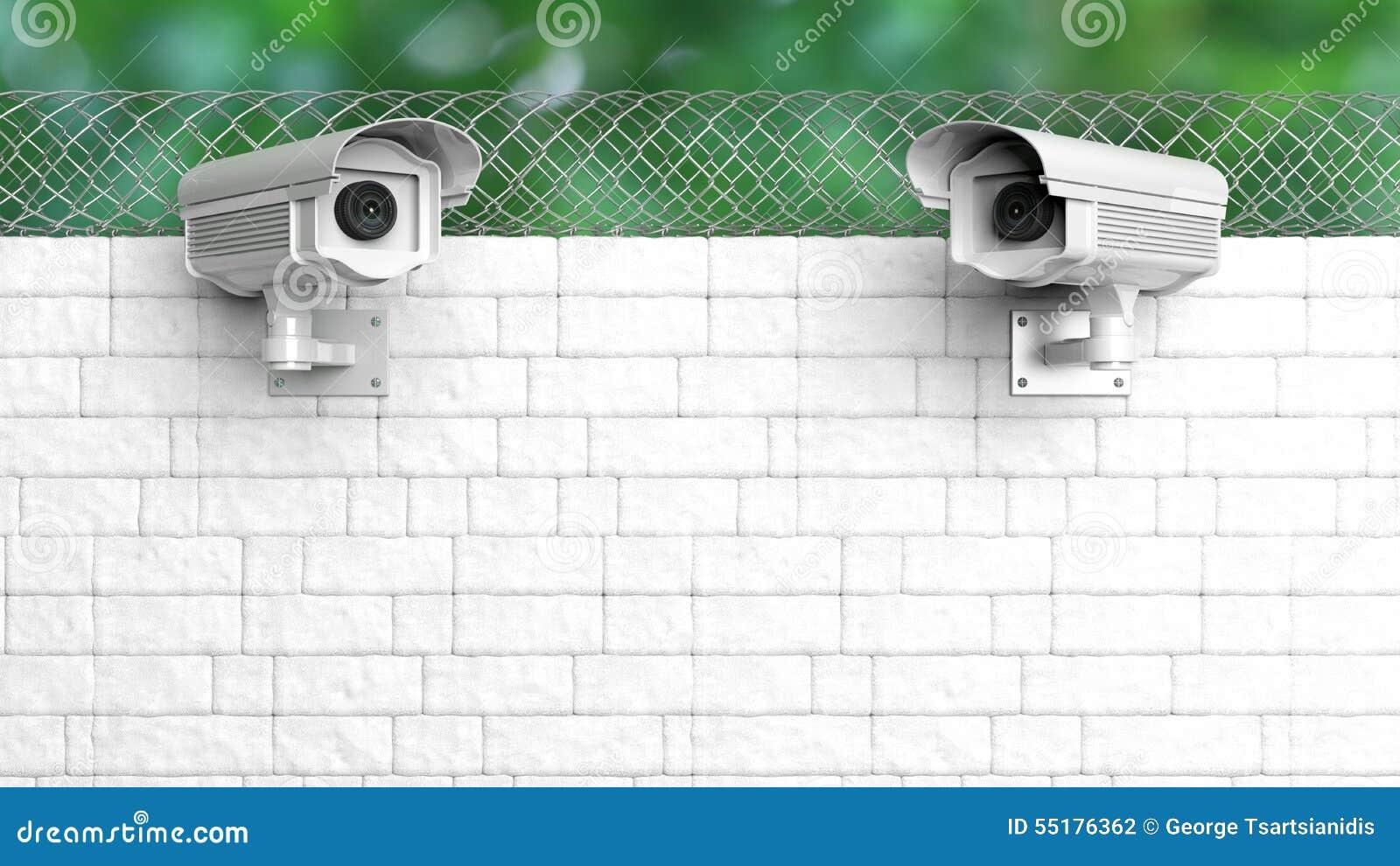 De camera van het veiligheidstoezicht op witte bakstenen muur