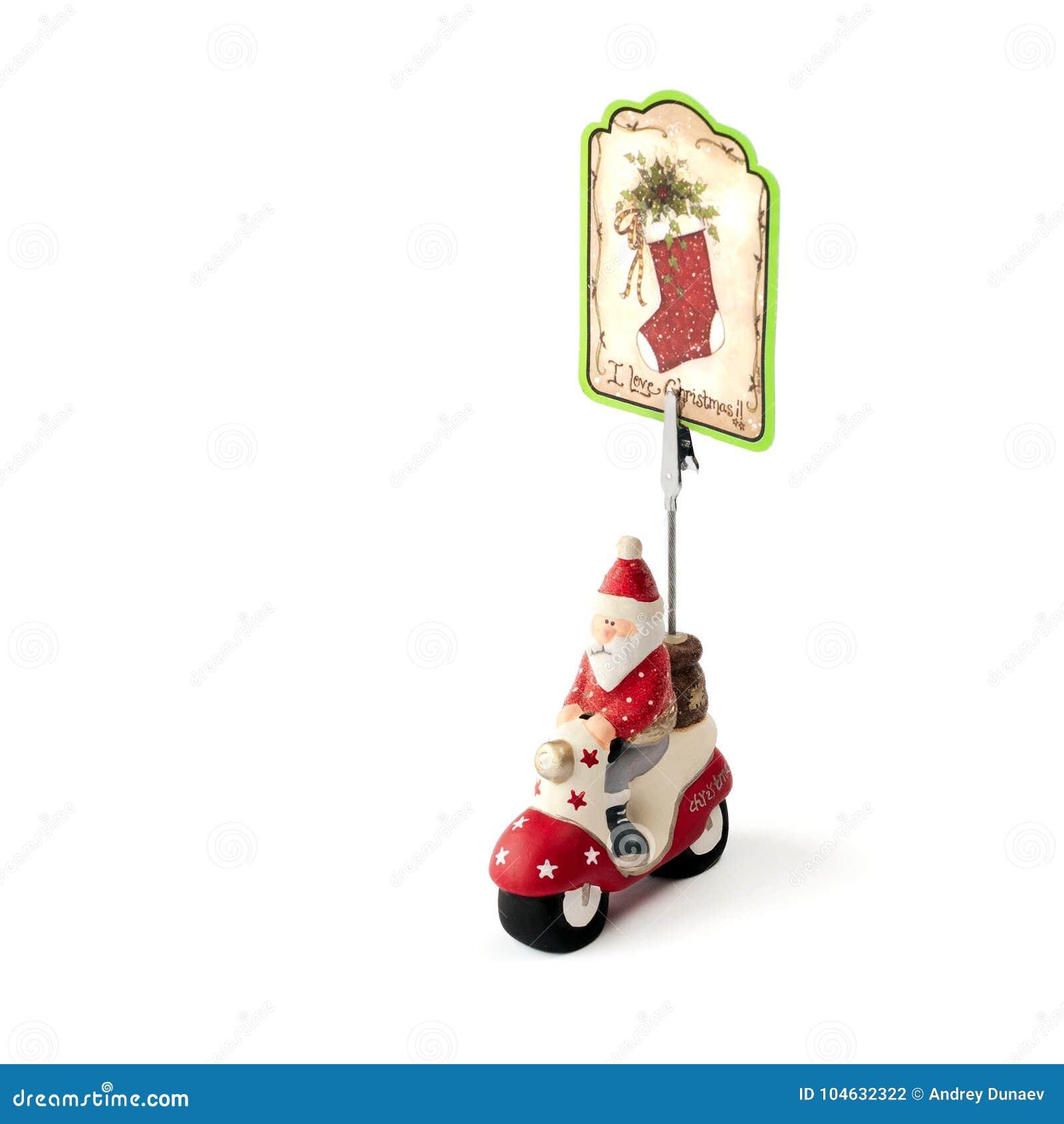 Download De Ceramische Kerstman Met Een Zak Op Motorfiets Op Witte Backgrou Stock Foto - Afbeelding bestaande uit vrolijk, tekening: 104632322