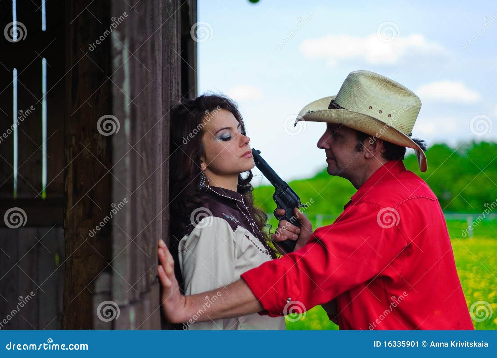 De cowboy met een pistool in handen